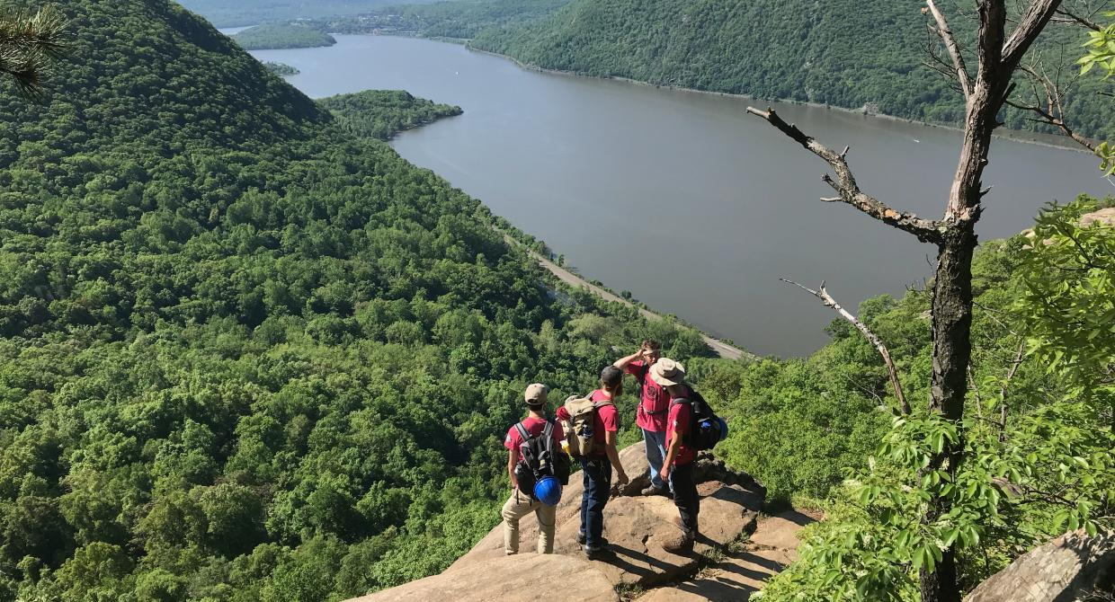 The Trail Conference's Taconic Crew Looks Out Over the Hudson River from Breakneck Ridge. Photo Credit: Erik Mickelson.
