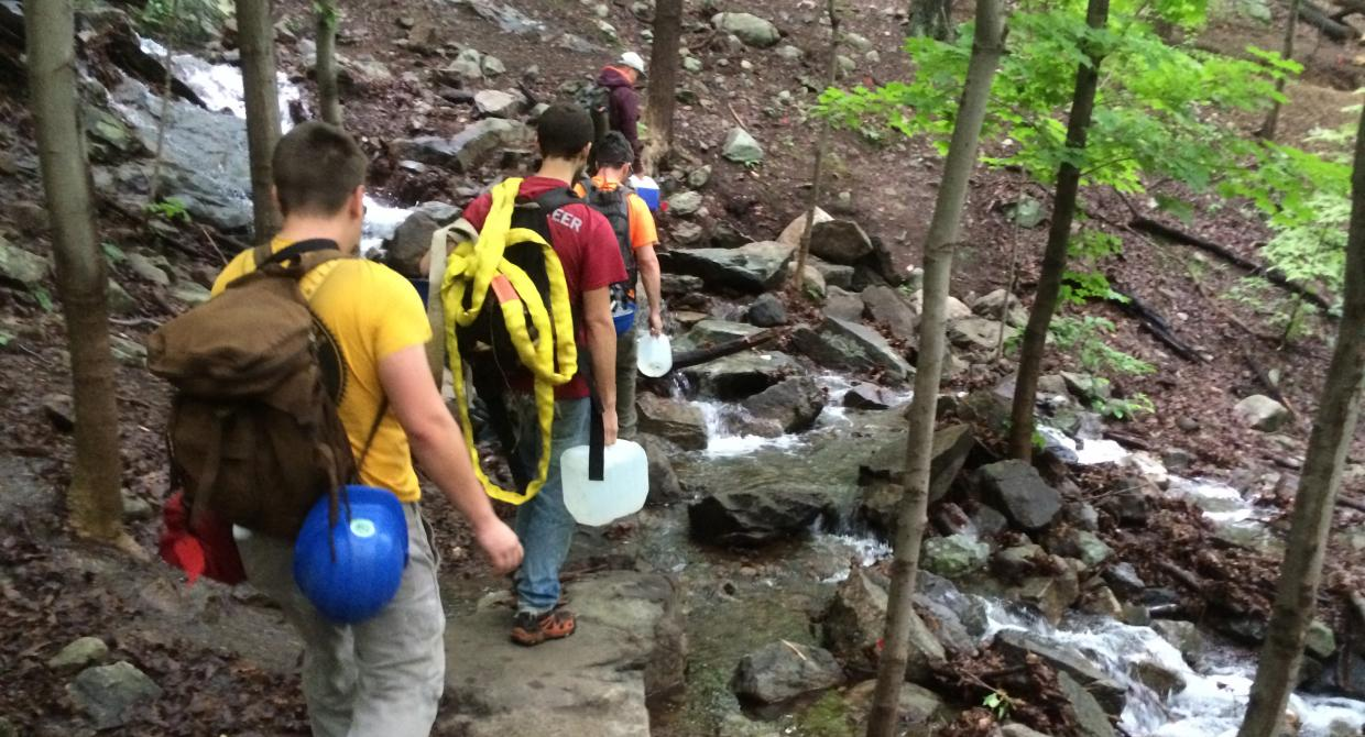 The Taconic Trail Crew hikes the Wilkinson Trail at Breakneck Ridge to get to their work site. Photo by Erik Mickelson